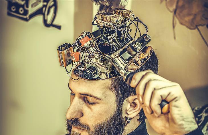 הטיות קוגניטיביות: איש עם ראש פתוח שבתוכו יש מנוע במקום מוח, ואותו הוא מתקן עם מברג