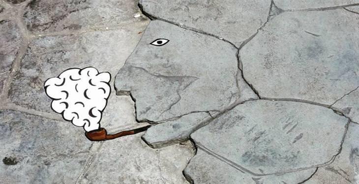יצירות גרפיטי שמשדרגות את הרחובות: סדקים במדרכה שיוצרים צורה של פרצוף