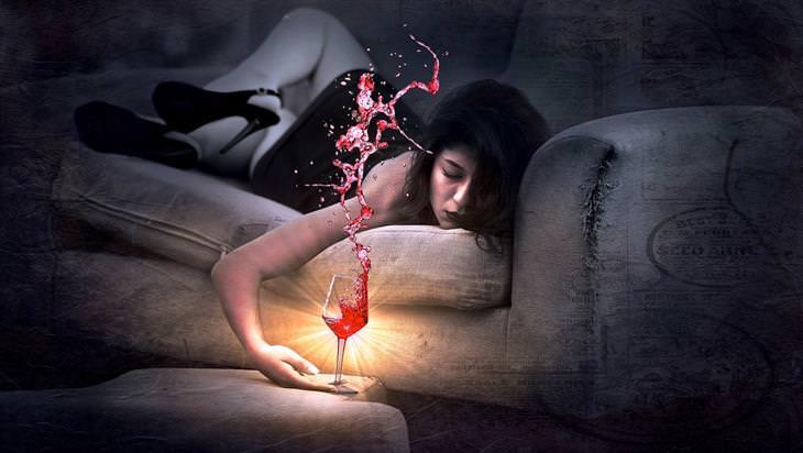 טעויות שמונעים מכם שינה ערבה: איור של אישה שוכבת על ספה עם כוס יין בידה