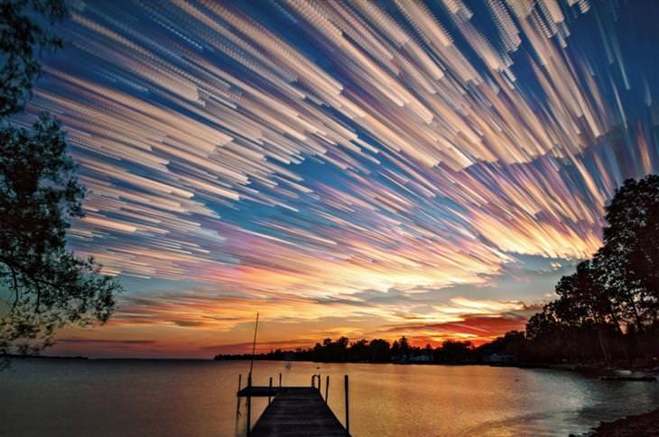 תמונות מדהימות: שקיעה מדהימה על רקע אגם