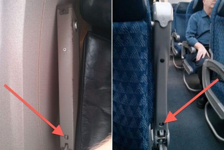 כפתור הרמת משענת היד במטוס ליד המעבר והחלון