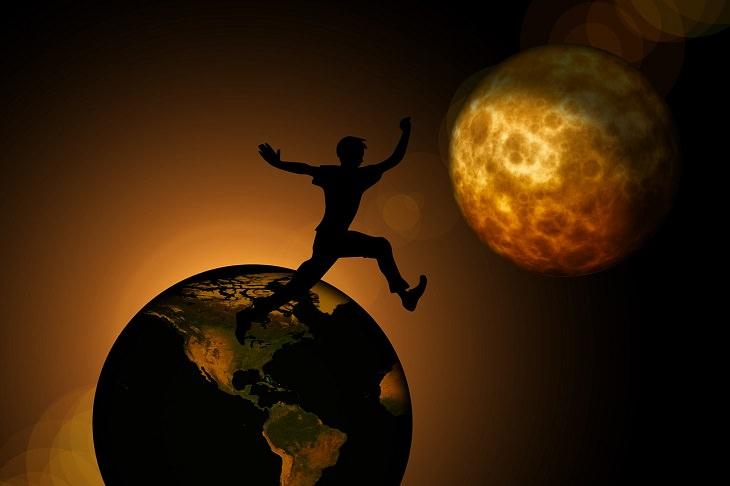 איור של אדם מקפץ מכדור הארץ אל כוכב אחר