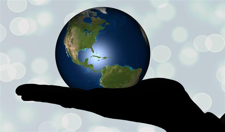 עצות להצלחה שצריך לקחת בערבון מוגבל: צללית של יד שמחזיקה את העולם