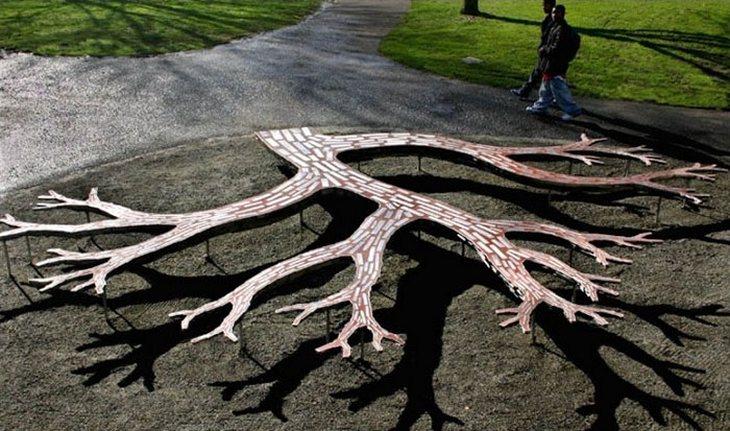 18 ספסלים יצירתיים: ספסל דמוי עץ עם ענפים