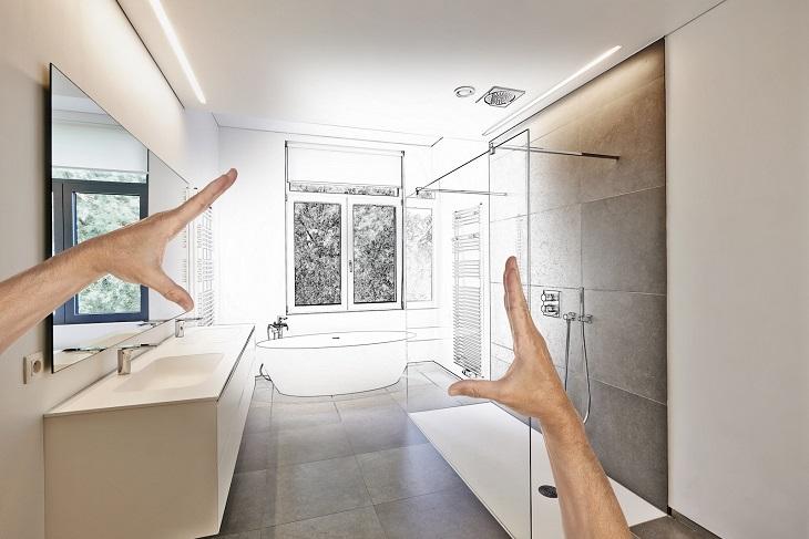 שיפוץ חדר אמבטיה: כפות ידיים פרוסות כמסגרת סביב ציור של אמבטיה