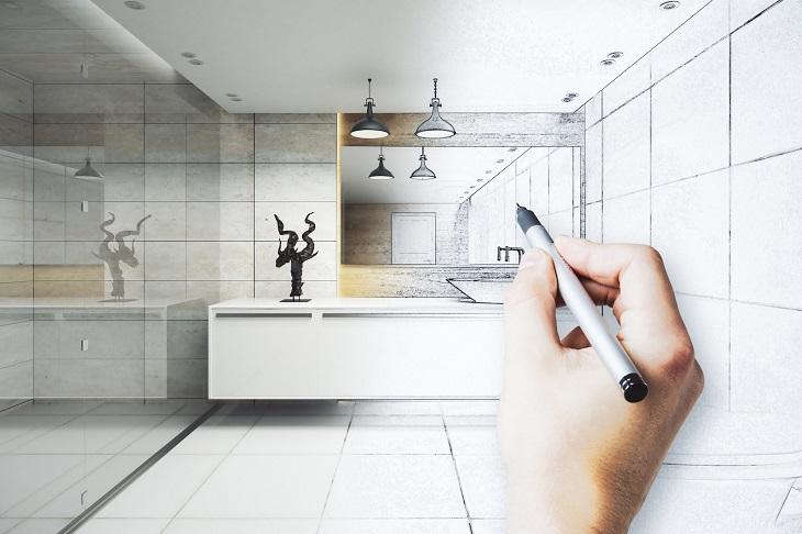 שיפוץ חדר אמבטיה: יד אוחזת עט ומציירת חדר אמבט