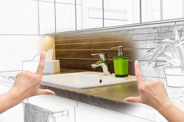 שיפוץ חדר אמבטיה: כפות ידיים פרוסות כמסגרת סביב עמדת כיור מצוירת