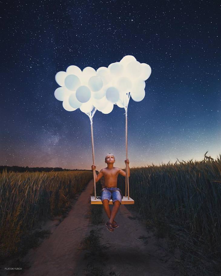 יצירותיו של האמן פלטון יוריך: ילד יושב על נדנדה הקשורה לבלונים כשברקע שדה זרוע כוכבים