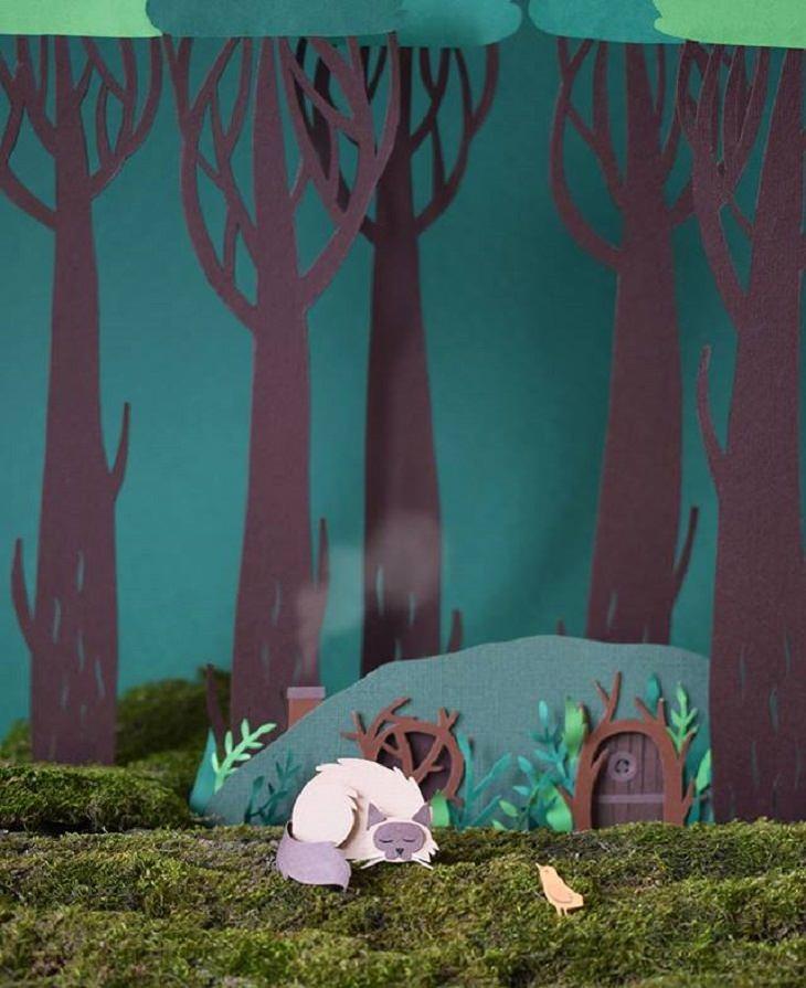 אומנות מגזרות נייר: שועל שוכב ליד בית ביער