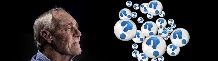 מחקר על שתלי מוחיים לשיפור הזכרון: אדם מבוגר שלידו מופיעים הרבה סימני שאלה