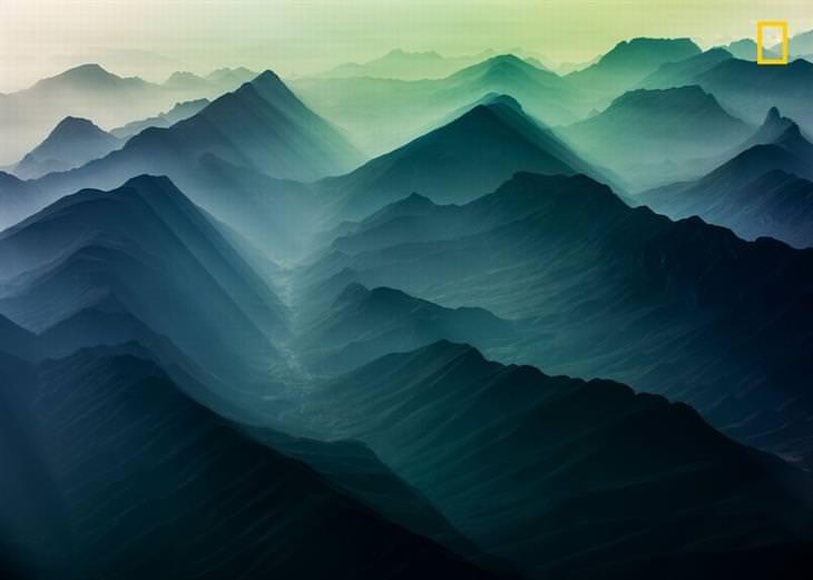תמונות טבע מדהימות מתחרות הצילום של נשיונל ג'יאוגרפיק 2018: הרי קורדילרה בשעת בוקר מוקדמת