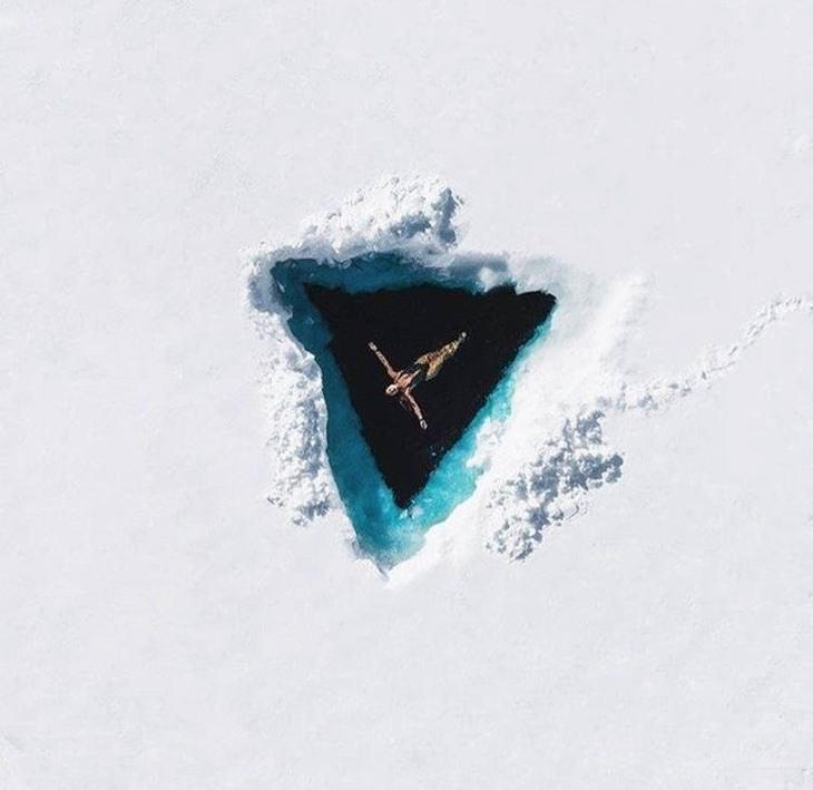תמונות נפלאות: אישה טובלת במים בתוך קרחון