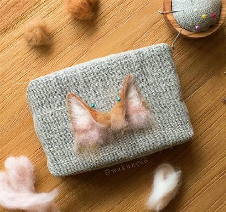 דיוקנאות של חתולים: אוזניים של חתול בתהליך יצירה