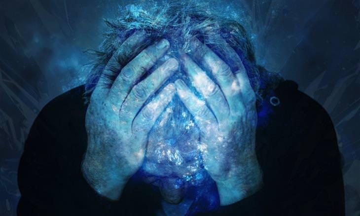 הסיכון בצריכת אספרטם: איש מחזיק את ראשו ונראה סובל