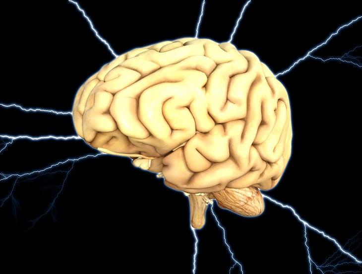 יתרונות בריאותיים של מנגו: איור של מוח על רקע הבזקי חשמל