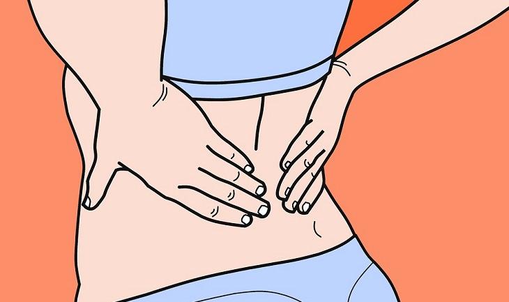 מתיחות להקלה על כאבי מפרקים בבוקר: איור של גב תחתון שאוחזות בו ידיים