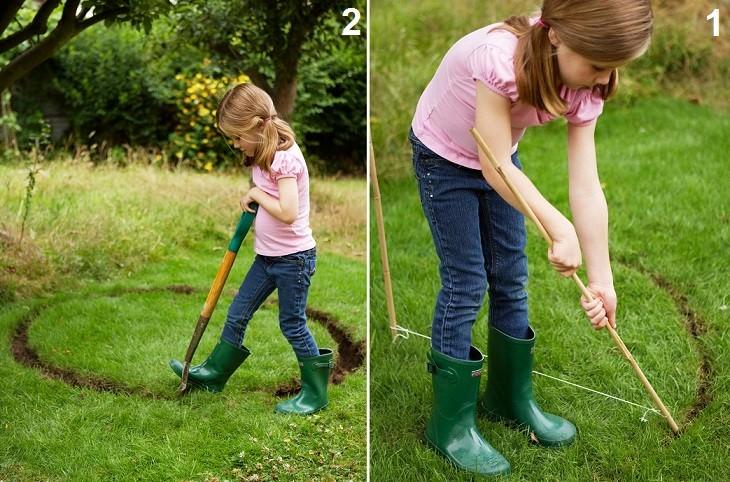 פעילויות גינה לילדים: ילדה חופרת עיגול באדמה