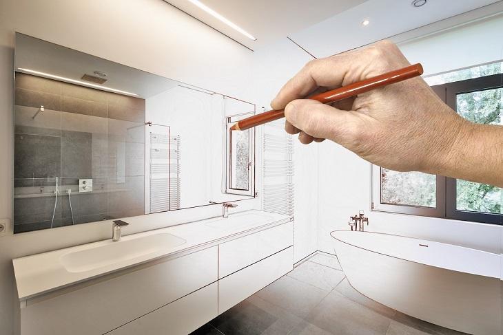 שיפוץ חדר אמבטיה: איור של יד אוחזת בעפרון ומציירת חדר אמבטיה