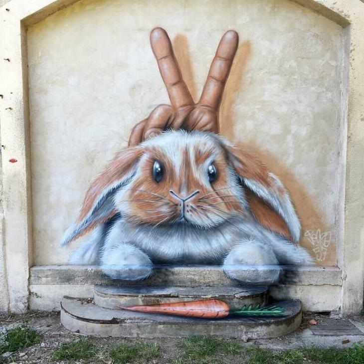 """יצירות אמנות רחוב: ציור קיר של ארנב שיד מאחוריו מסמנת """"וי"""""""
