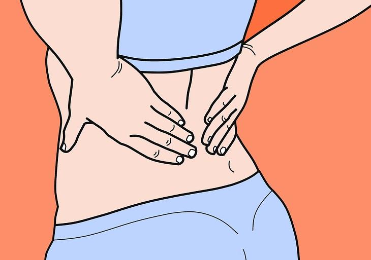 תרגילים ויתרונות לחיזוק שרירי הליבה: ציור של אישה מחזיקה את הגב התחתון