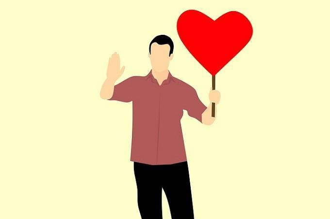 מבחן אישיות: איור של גבר אוחז בשלט בצורת לב בידו