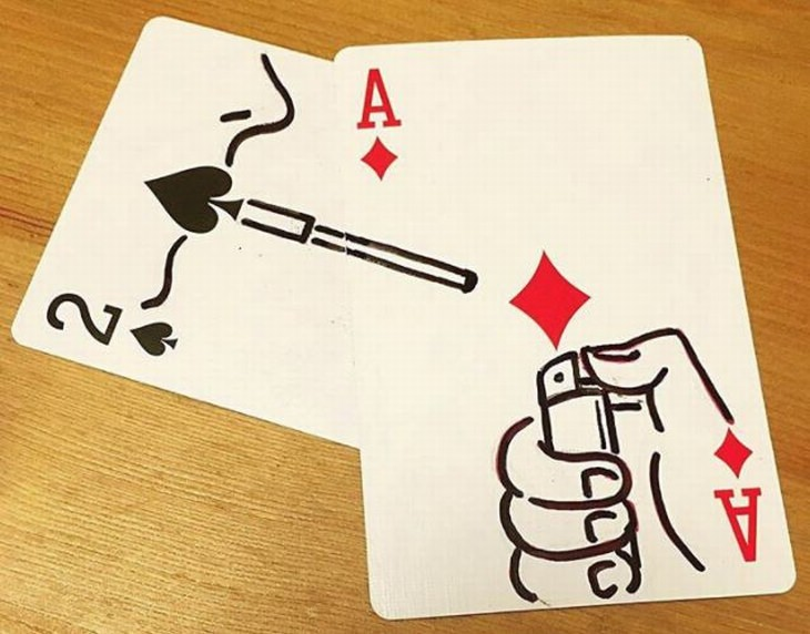 ציורים מינימליסטיים מקסימים: ציור על קלפים בעזרת הסימנים שעליהם שנראה כמו אישה שמדליקים לה סיגריה