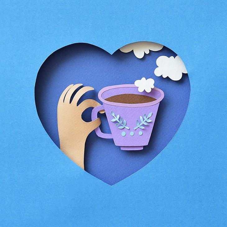אומנות מגזרות נייר: יד אוחזת בכוס קפה במסגרת לב