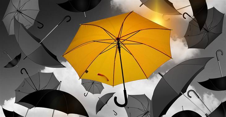 דברים קשים שצריך לשמוע על הגישה לחיים: מטריה צהובה ומסביבה שלל מטריות אפורות באוויר