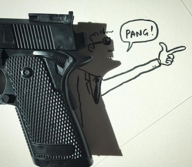 ציורים עם צל: ציור של איש מצביע עם ידו בצורת אקדח