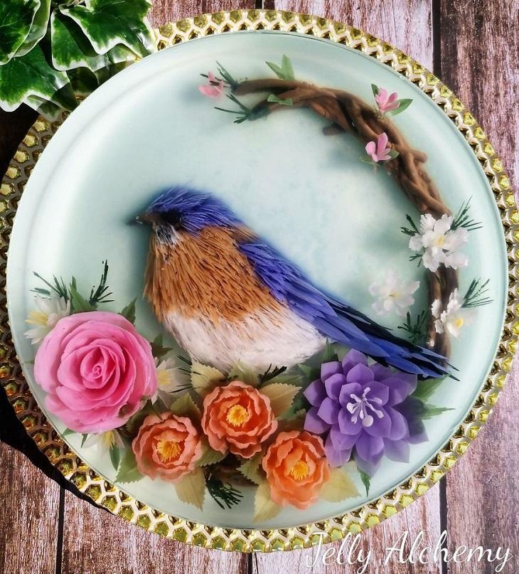 עוגות ג'לי בתלת ממד: ציפור צבעונית יושבת על פרחים