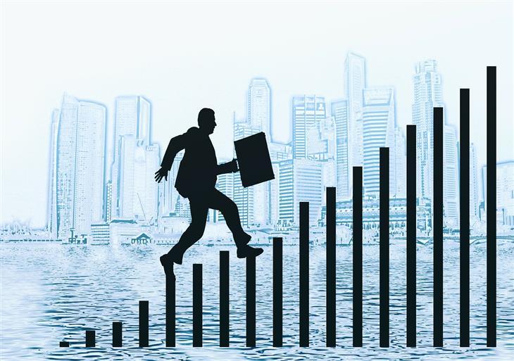 התמכרות לעשייה: איור של איש צועד על גרף עולה