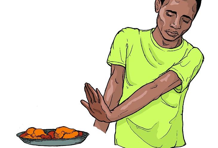 סימנים להופעת לוקמיה: איור של אדם מסמן בידו שאינו מעוניין בצלחת אוכל המוגשת לו