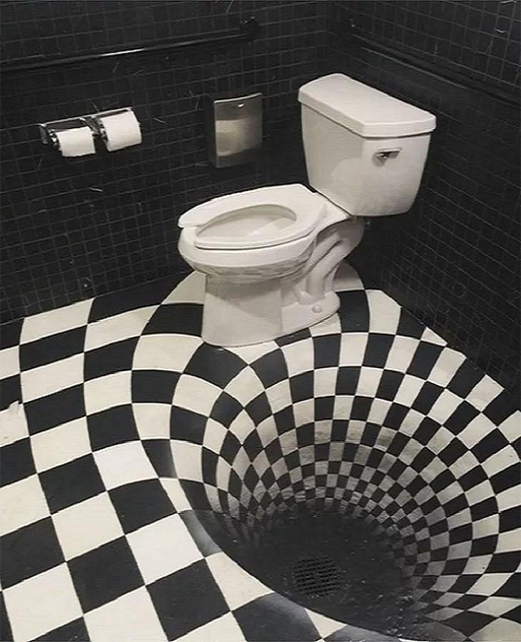 שירותים הזויים: תא שירותים עם רצפה מבלבלת