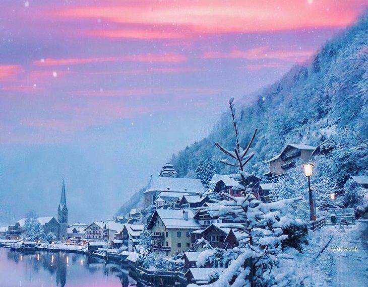מראות החורף הקסומים: פתיתי שלג על גבעה