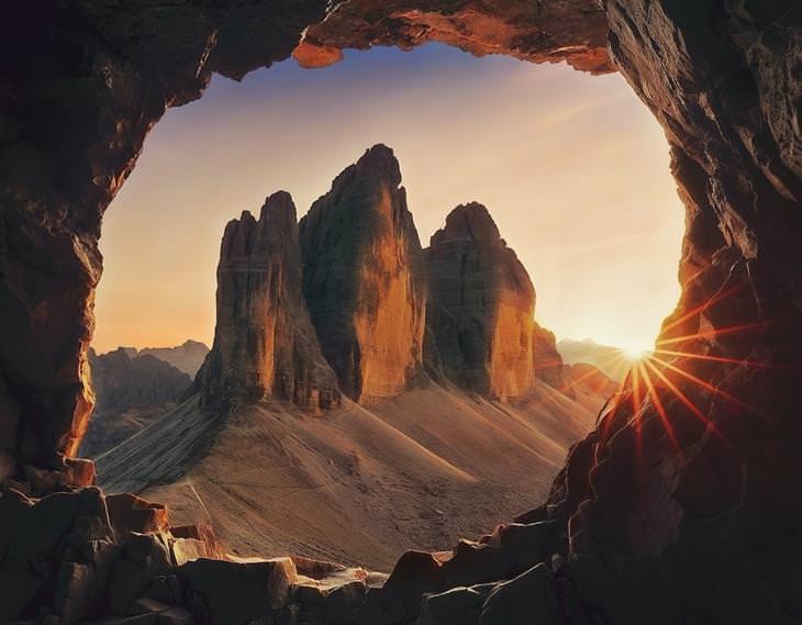 תחרות צילום של סוני 2020: שקיעה במדבר דרך פתח מערה
