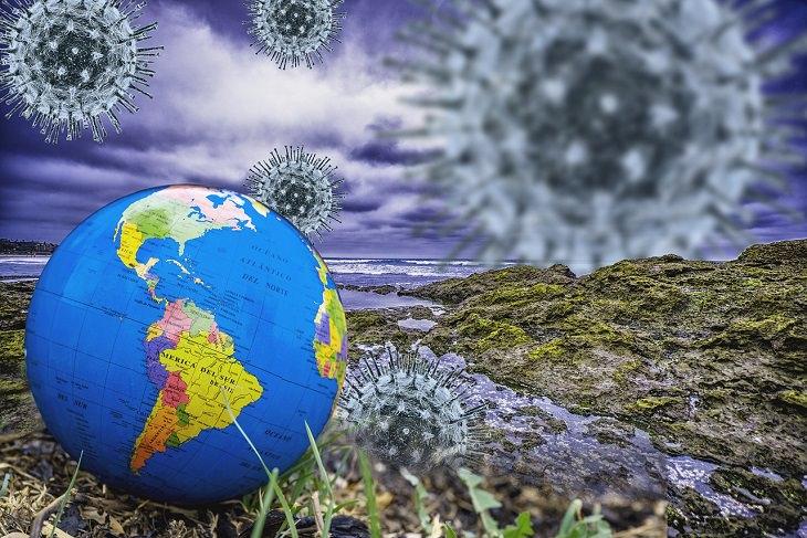 8 שינויים בעולם התיירות אחרי הקורונה: איור של כדור הארץ על רקע נגיפי קורונה גדולים