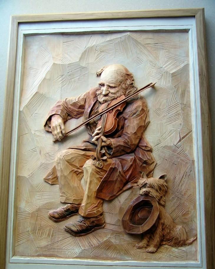 ציורים באמצעות פיסול עץ: נגן כינור וכלב