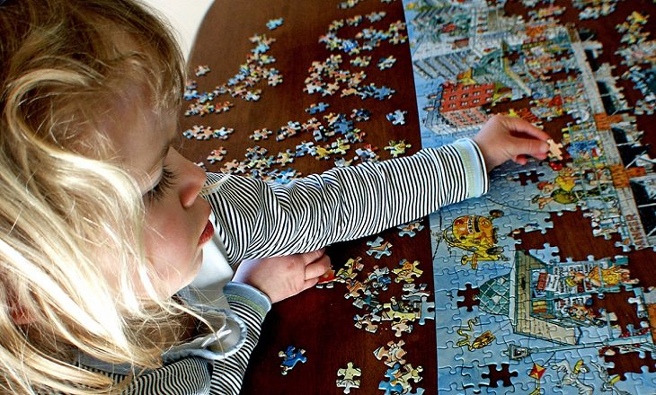 girl solving a puzzle