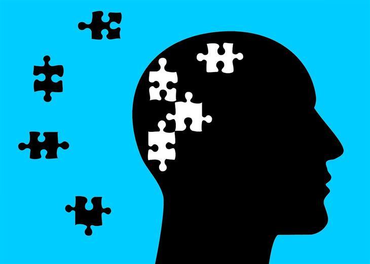 אפקטיבייט לשיפור הזיכרון: איור ראש אדם שמחולק לחתיכות פאזל