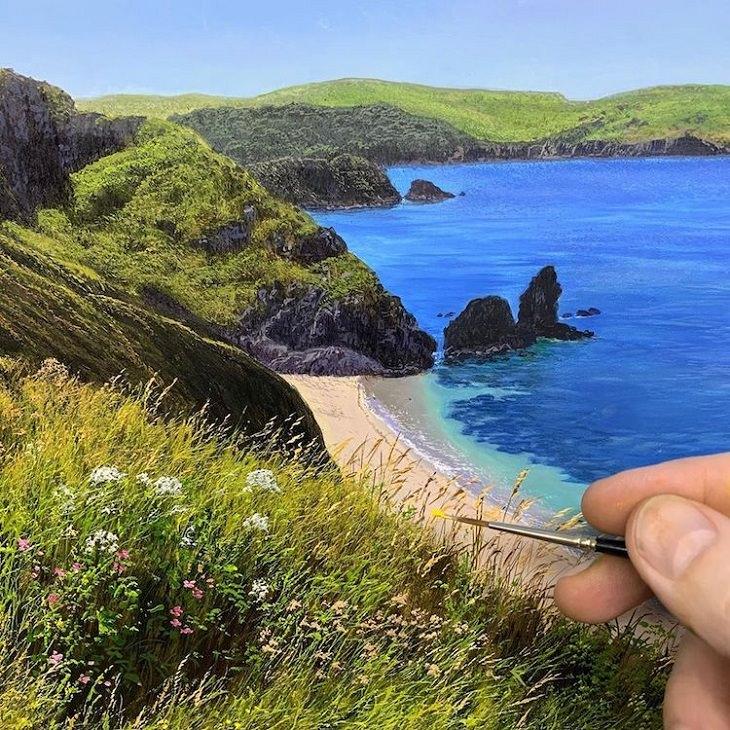 ציורי שמן של נוף כפרי: ים בסמוך להרים וסלעים