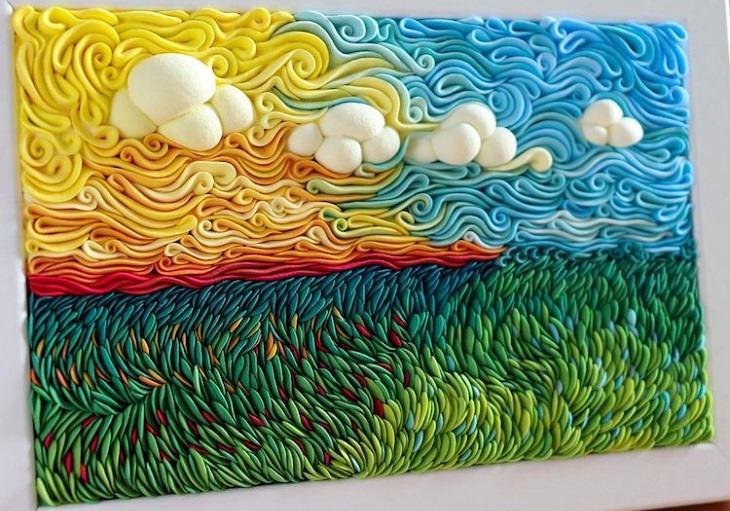 תמונות נוף מחימר פולימרי: שדה ומעליו שמיים בגוונים צהוב וכחול, ועננים