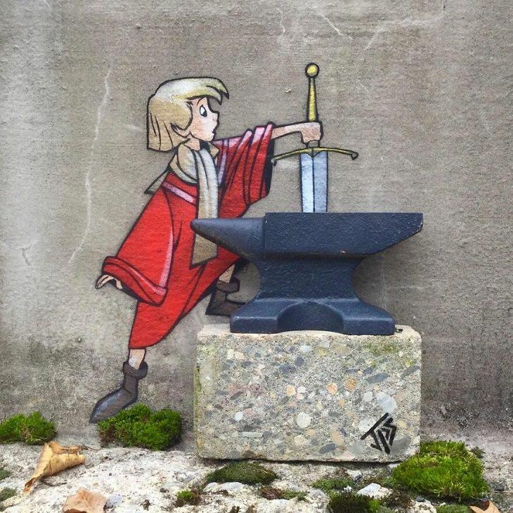 יצירות גרפיטי של האמן JPS: ציור רחוב של ילד מוציא חרב מתוך סדן