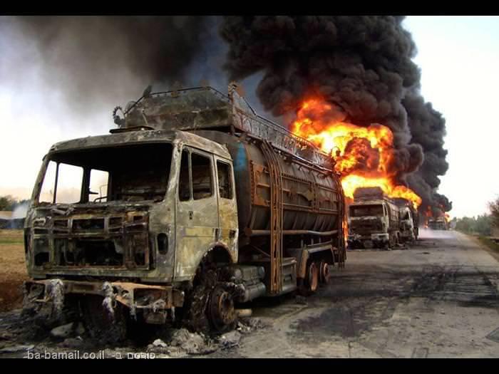 אפגניסטן, שיירת משאיות, רכב שרוף, פיצוץ