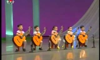נגני גיטרה צעירים מצפון קוריאה בביצוע מרשים במיוחד