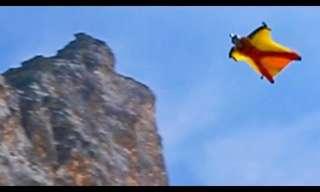 קופצי בסיס בחליפת כנפיים מעל נופי שוויץ