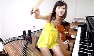 כמה כישרון! הטיוואנית שמנגנת מוצארט על 3 כלי נגינה בבת אחת
