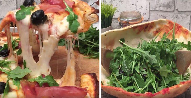 מתכון לפיצה משפחתית המוגשת לצד קערת סלט אכילה מבצק הפיצה
